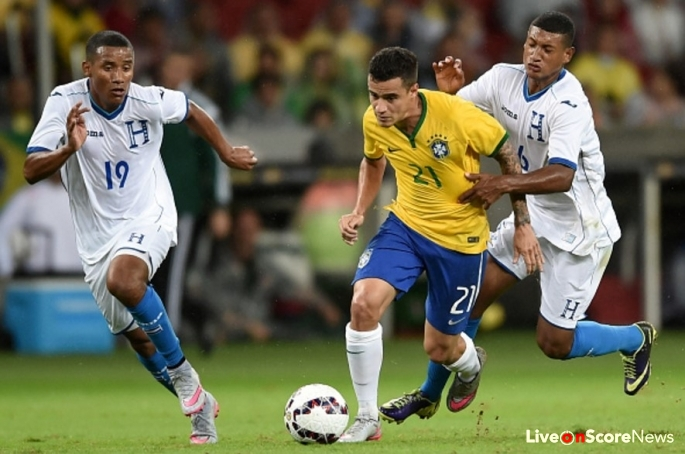 brazil-midfielder-philippe-coutinho-middle-dribbles-past-two-honduran-defenders